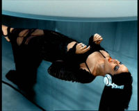 "Aaliyah in the video for the 2001 single ""We Need a Resolution"""