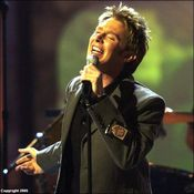 Aiken singing at the 2003 Billboard awards