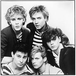 In 1981, Duran Duran consisted of Nick Rhodes and Simon Le Bon (rear), and the unrelated Taylors: Roger, Andy, and John (front).