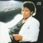 The original album cover to 1982's Thriller. The special edition cover features Jackson holding a tiger cub.