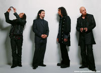 Photo of the band, from the official web site. From left to right: Daron Malakian, John Dolmayan, Serj Tankian, Shavo Odadjian